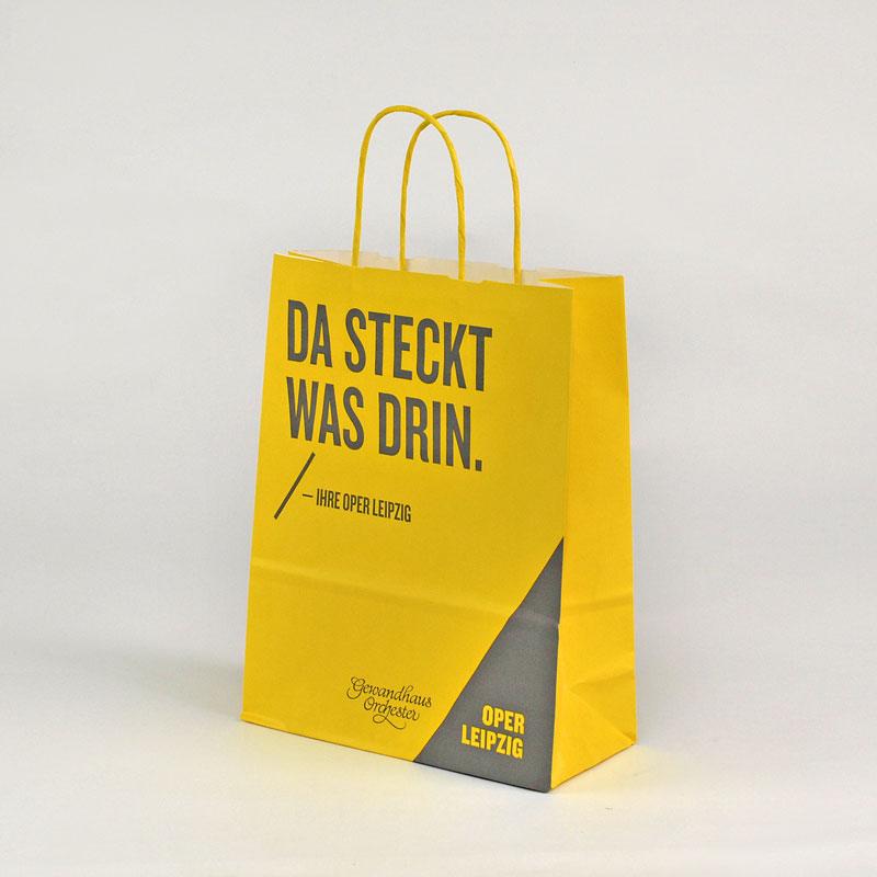Kleine Papiertasche mit gedrehter Papierkordel in gelb